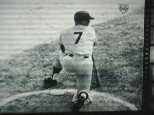 Mickey Mantle kneels in the on-deck circle