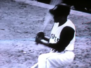 Roberto Clemente on one knee in the on-deck circle